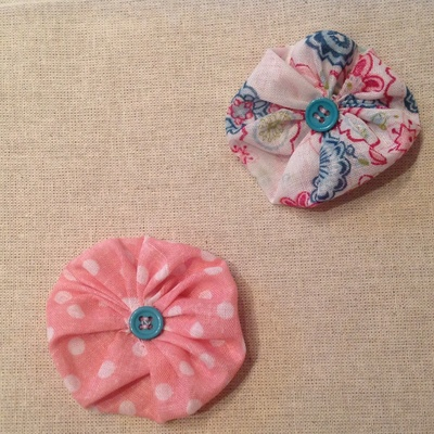 Button, fabric puffs
