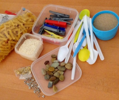 Recyclables, containers, boxes, sand, pegs, rocks
