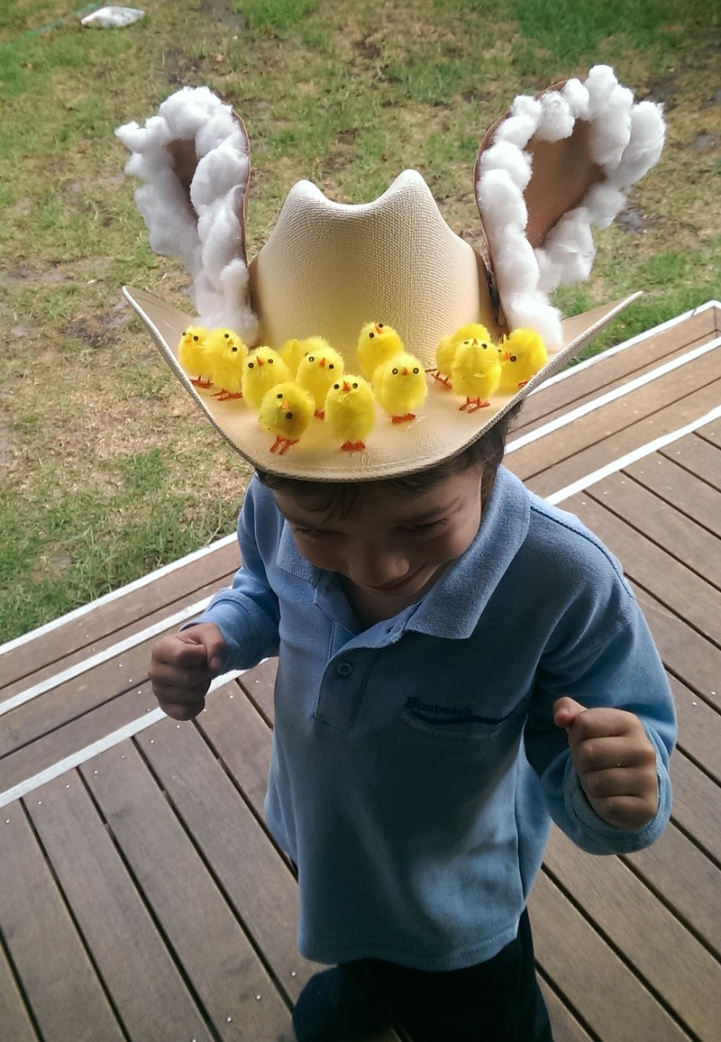 This hat was very easy. A toy duck sewn onto a hat. Painted plastic glasses were glued on - it was supposed to be an Easter version of my daughter reading her school newsletter. Photo: Kellie, NSW; This hat is made from 2 polystyrene balls covered in crepe paper and attachments glued on. Photo: Kellie, NSW; This hat is about saving the Bilby.
