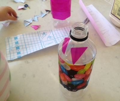 decorating plastic bottle with contact paper, decorating plastic bottle with patterned sticky back plastic, kids craft, fun kids craft idea