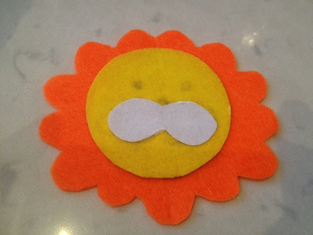 gluing lion face, making a card out of felt, felt greeting card, kids cards, kids birthday card  - Lion Birthday Card