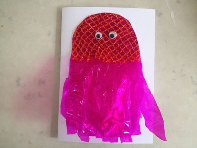 orange net to make jellyfish card, onion net on jellyfish card, craft ideas with net packaging, birthday card for first birthday, 1st birthday homemade card, handmade card idea, baby birthday card