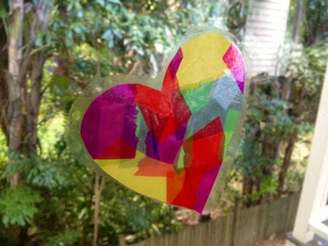 heart shaped suncatcher on window, stained glass kids craft