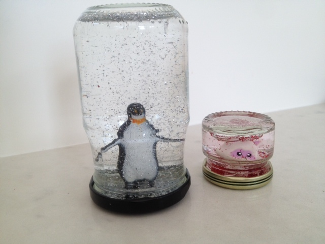 snow globe, make your own glitter globe, winter craft snow, snow craft, snow glitter, swirling glitter in jar, figurine glitter jars, snow storm jars