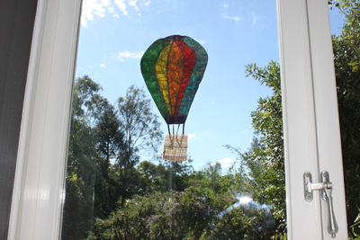hot air balloon picture in window, batik hot air balloon, flying hot air balloon picture