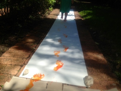 kids craft messy play paint footprints runway