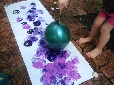 kids messy play activity, balloon paint splat