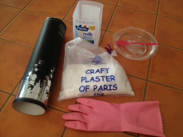 plaster drying in rubber glove, washing up glove with plaster of paris, rubber washing up glove, pink glove