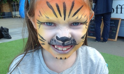 Orange face paint, tiger face paint