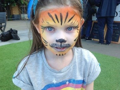 Orange face paint, yellow face paint, whiskers, tiger