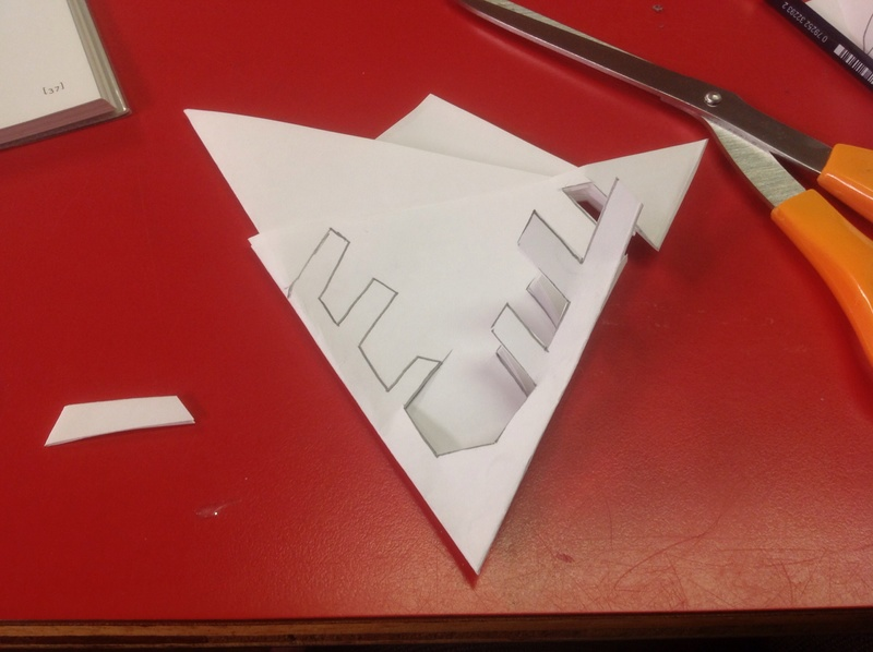 White paper, triangle, red table  - Cut-out Snowflakes