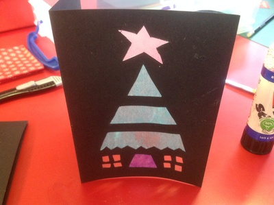 Green tissue paper, red table, black card, Christmas tree