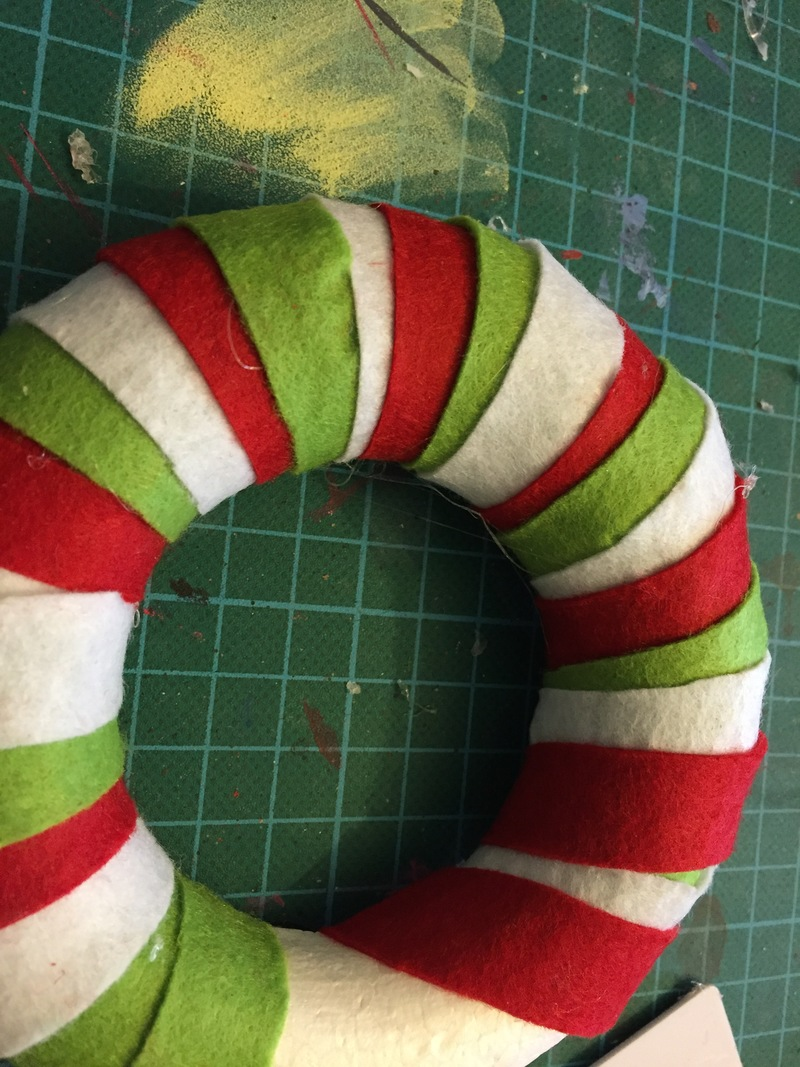 Polystyrene ring, red felt, green felt, white felt, Christmas wreath
