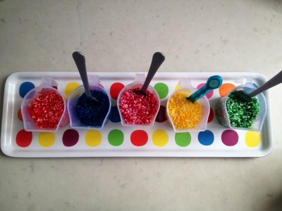 multi colour rainbow rice, pots of coloured rice, pots of dyed rice, baby rice colour to play with