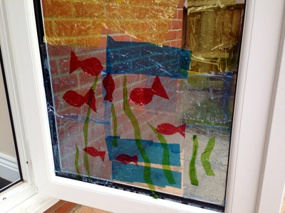 Window cling art, cellophane on windows, kids craft windows, stained glass windows kids, kids craft ideas