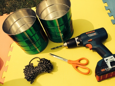 2 cans, scissors, drill, rope