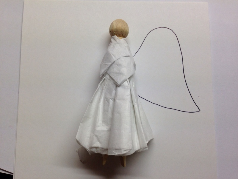 Angel with tissue paper dress