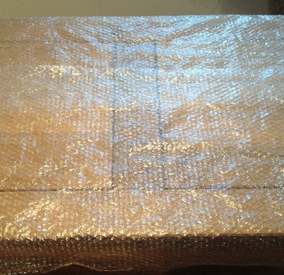 Table, bubble wrap, covered