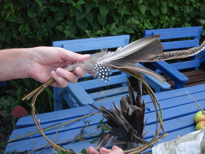 Attach the groups of feathers to the frame