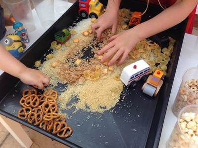 Cereal car box, car activities for toddlers, car activities for preschoolers, driving toy cars through cereal and rice