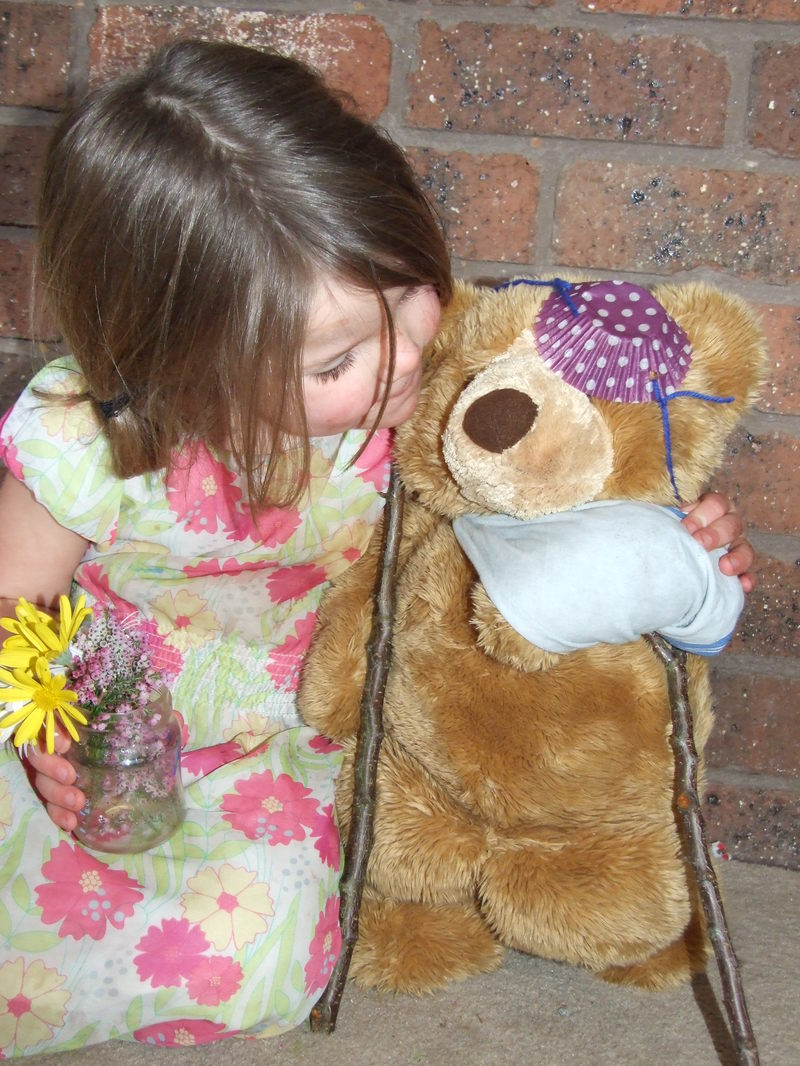 crutches, eye patch, sling, teddy