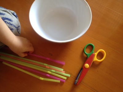 cutting up straws with scissors