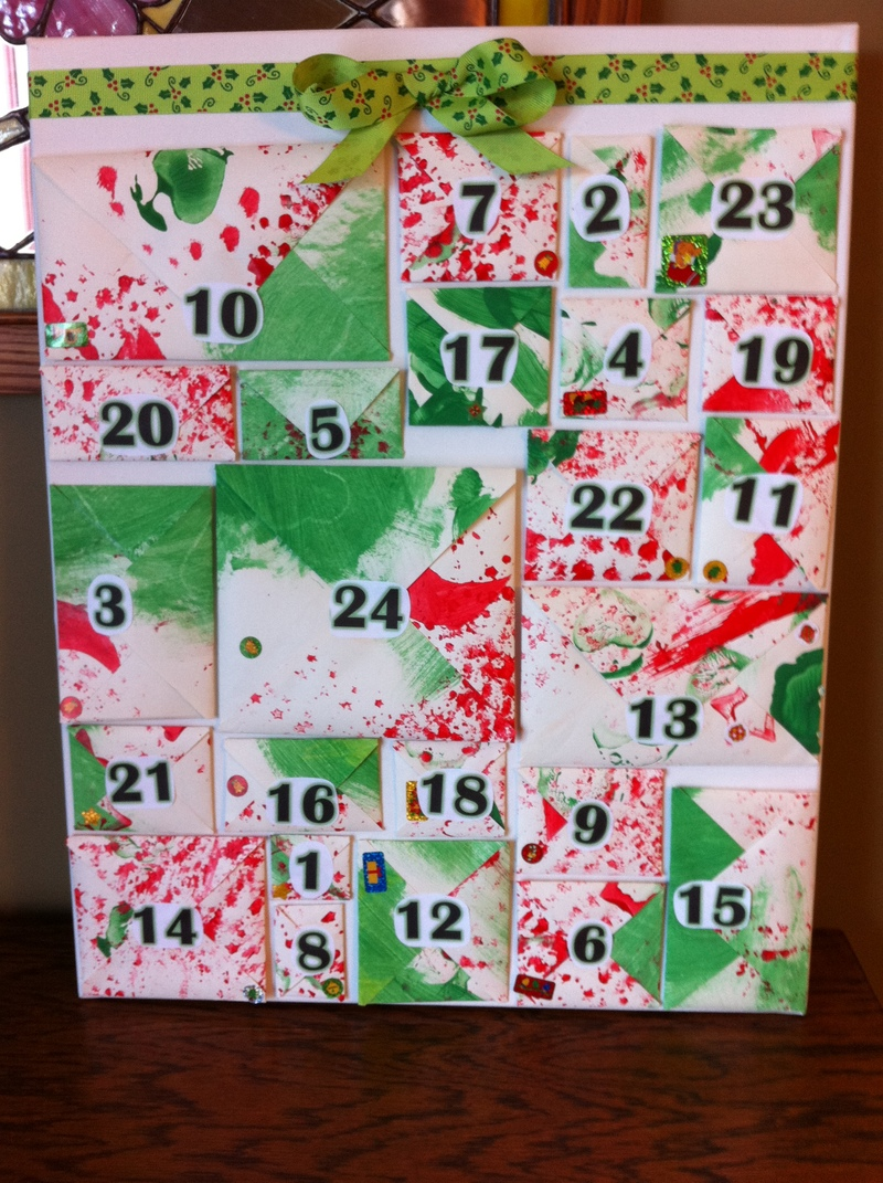 glue in place and add bow  - Envelope Activity Advent Calendar