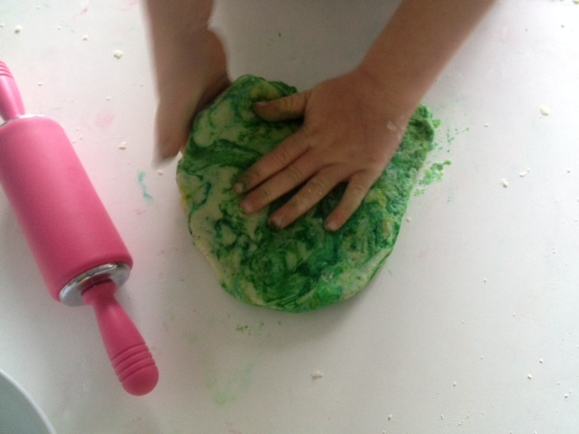 play dough little hands, toddler hands play dough, green play dough ball, kids playing iwth play dough, messy play outdoors play dough, play dough recipe