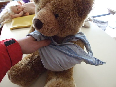 sling, teddy, triangular bandage, handkerchief