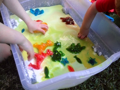 ice shapes, food colouring ice shapes, ice goop, ice in slime, ice messy play, slime messy play, colourful ice in goo