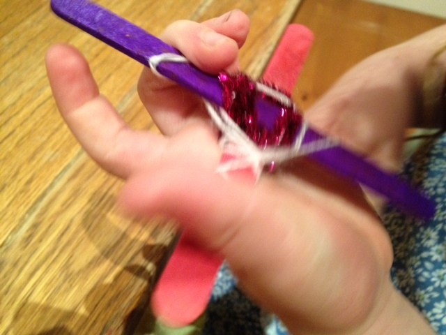 cheap kids craft weaving with popsicle lolly sticks and pipe cleaners