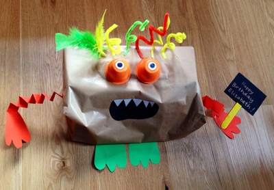 Monster present wrapping, fun wrapping ideas, kids present wrapping, how to wrap a difficult shaped present, monster, kids craft monster