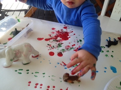 polar bear prints in paint, making animal paw prints, making animal footprints, toddler hands printing
