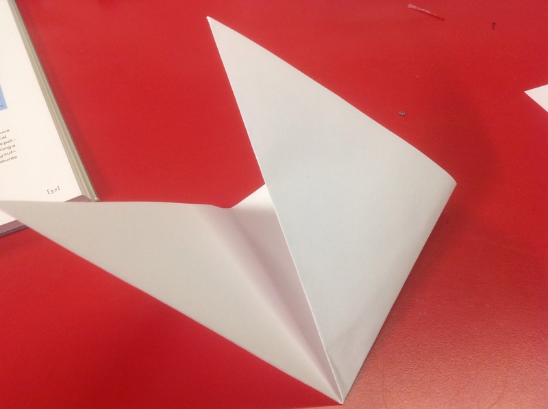 Sheet square paper, red table, white paper, cut-out snowflake  - Cut-out Snowflakes