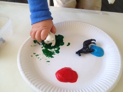 polar bear in green paint, plastic turtle, paint with plastic figures, unusual print ideas, kids print ideas, my kid craft, messy fun for kids