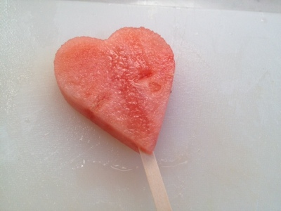 popsicle stick in watermelon, making a lollipop, watermelon lolly stick, freezing watermelon, freeze watermelon, fun food watermelon, kids party food