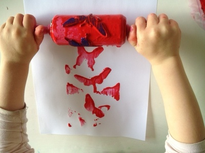 rolling with rolling pin in paint kids art idea