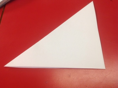 Sheet square paper, red table, white paper, cut-out snowflake