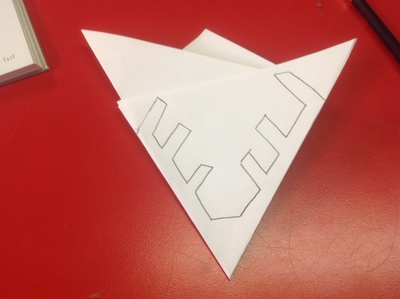 White paper, triangle, red table